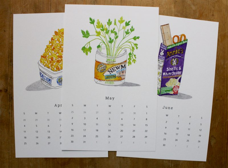 March, April, May pages of the simple living with trash 2021 wasll calendar with hand painted watercolors of gold fish, Newman's own salsa and Annie's mac and cheese by messy bed studio