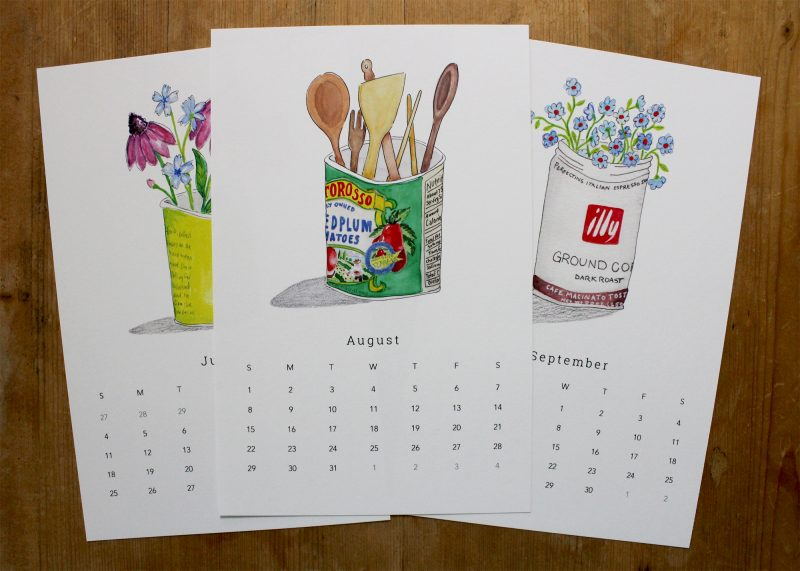 June, July and August of the simple living with trash 2021 wall calendar with hand painted images of Trader Joe's jackfruit can, Tutorosso tomatoes and Illy coffee by messy bed studio