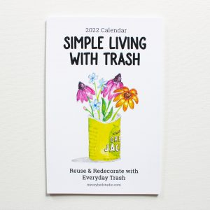 Simple living with trash 2022 wall calendar cover with watercolor painting of flowers in a recycled food can