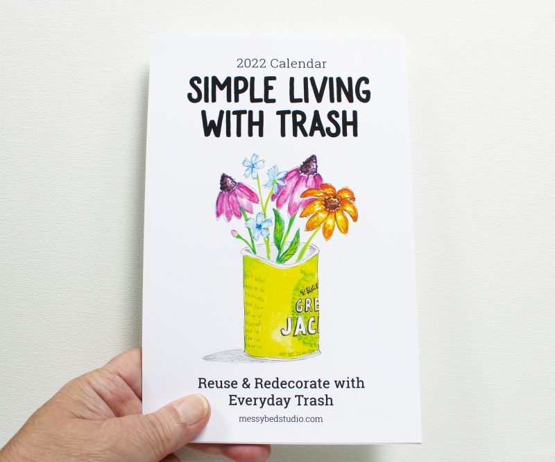 Simple Living with Trash 2022 wall calendar held in a hand