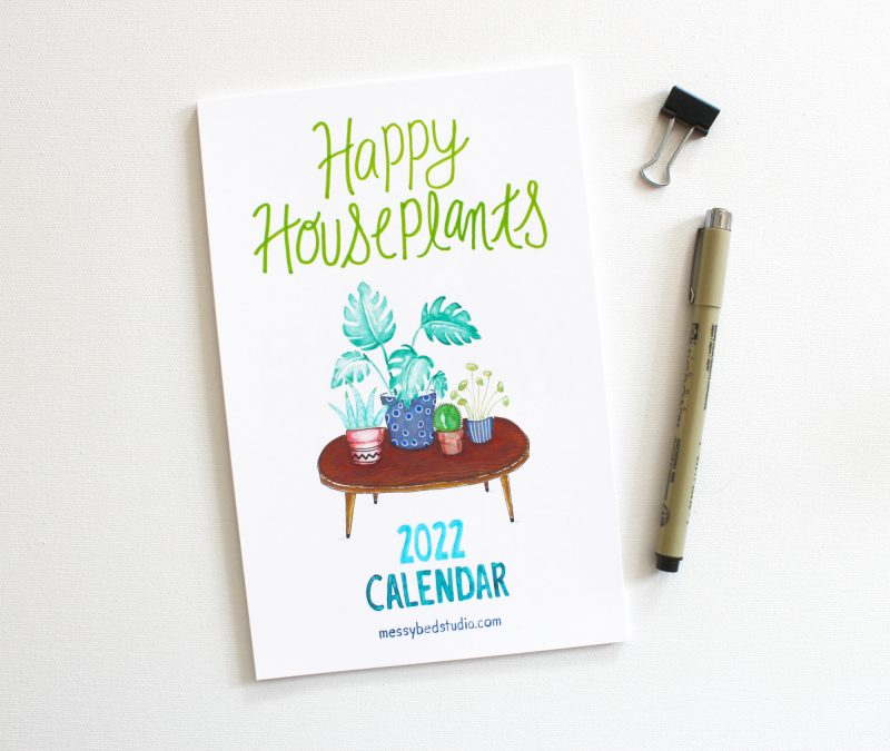 2022 plant mom calendar cover handpainted in watercolors shown with pen and clip